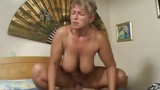 Mature Woman fucks her son's friend after catching him masturbating